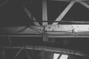 Thick wooden support beams in the rafters of a building.